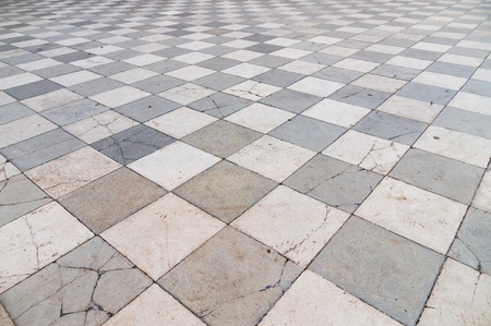 ''wide angle'': Old and partly cracked tiled floor, wide angle perspective view