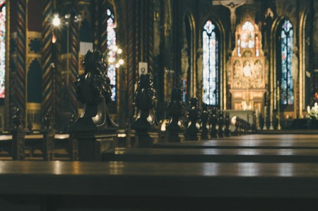 toned: Blurred toned image background of cathedral interior