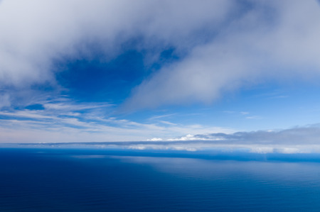 high angle view: Cloudy sky and calm ocean background, high angle view Stock Photo