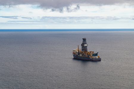 capping: Exploratory offshore drilling by drillship, from above view