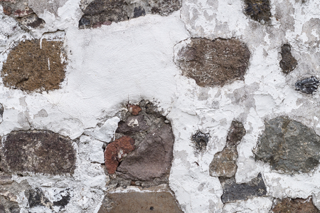 quicklime: Grungy background of damaged limewall with stones Stock Photo