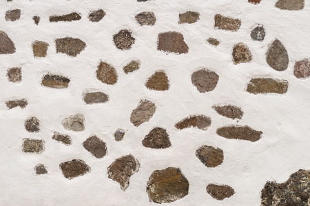 quicklime: Background of limewall with different size and shape stones