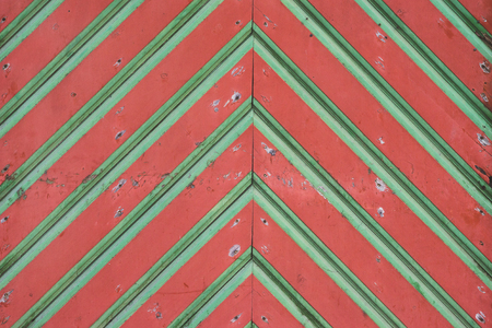 bad condition: Closeup on old red-green wooden gates in bad condition, medieval style architecture Stock Photo