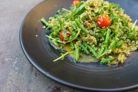 green bean: Yellow beetroot carpaccio with quinoa, rucola, green bean salad and pumpkin seeds