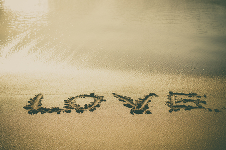 wrote: Love text wrote on beach sand Stock Photo