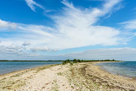 rocky point: Point of the Saare rocky coastline against scenic cloudscape, Kassari island, Estonia