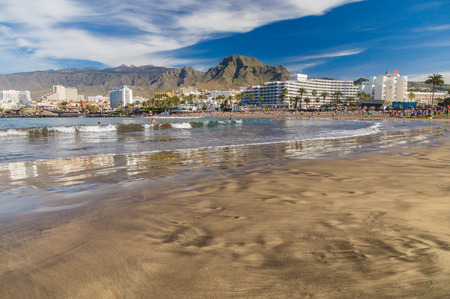 troya: TENERIFE, SPAIN - January 23, 2016: Crowd of people swimming and sunbathing on the picturesque Playa de Troya beach of Costa Adeje resort. Editorial