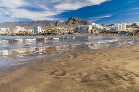 TENERIFE, SPAIN - January 23, 2016: Crowd of people swimming and sunbathing on the picturesque Playa de Troya beach of Costa Adeje resort. Editorial