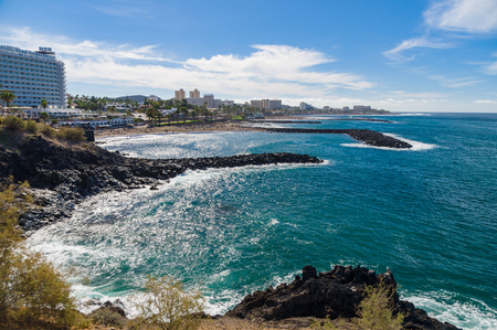 TENERIFE, SPAIN - January 23, 2016: Perspective view on coastline and beaches of Costa Adeje resort by sunny day.