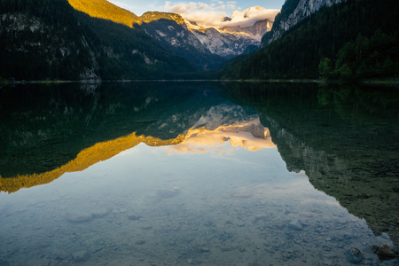 water fall: Vorderer Gosausee lake and Dachstein range before sunset view. Salzkammergut, Austria