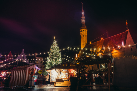 TALLINN, ESTONIA - NOVEMBER 20, 2016: Traditional winter holidays market in Tallinn old town. Very long history dating back to 1441 when the first Christmas tree was displayed in Tallinn.