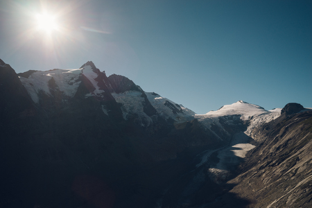 hochalpenstrasse: Grossglockner mountain and Pasterze glacier against sun, Carinthia and East Tyrol, Austria