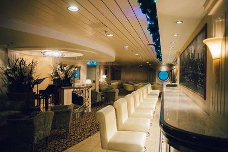 conveniences: STOCKHOLM, SWEDEN - JAN 12, 2017: Interior of the piano bar Manhattan at the Baltic Queen cruise ferry operated by Tallink, one of the largest shipping companies in the Baltic Sea region. Editorial
