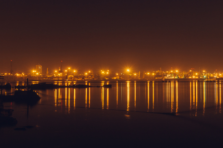 Freight harbor at night with lights reflection on water, long exposure image, Odessa, Ukraine