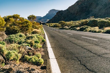 Scenic empty road with mountains on background, Tenerife, Canary islands, Spain Stock Photo