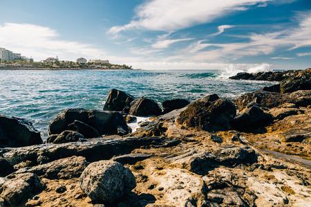 Wonderful view on rocky coastline of Costa Adeje resort by sunny day, Tenerife, Spain