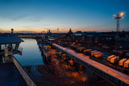 Helsinki, Finland - March 31, 2017:  After sunset view from cruise ferry on city and Katajanokka Harbour infrastructure.