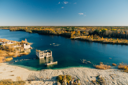 Abandoned Rummu quarry from above view. Autumn landscape by sunset. Harjumaa, Estonia.