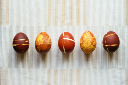 Five decorated Easter eggs, unusual home made painting with onion skins