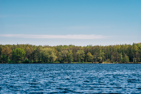 Beautiful lakeside against blue sky by spring sunny day. Saadjarve, Estonia