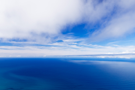 Wonderful cloudy sky and calm ocean background, high angle view