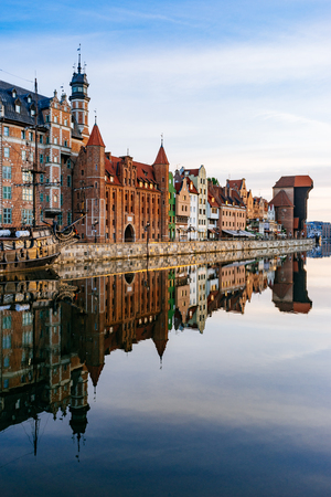 Wonderful morning view on the embankment of Motlawa river with reflection on water, Gdansk, Poland