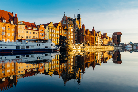 Sunrise view on the riverside of Motlawa river with wonderful buildings of Gdansk old town, Poland Stock Photo