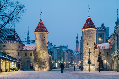 Tallinn, Estonia - January 7, 2017: Famous landmark Viru Gate illuminated by the street lights. Popular touristic place for winter holidays.