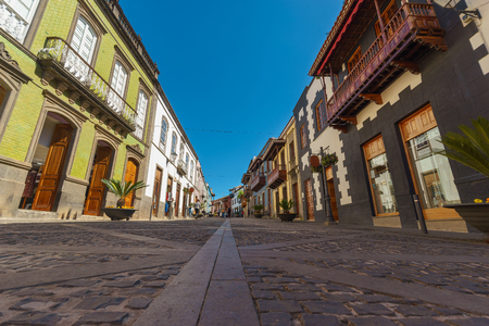 Teror, Spain - February 27, 2018: Calle Real de la Plaza, main pedestrian street with traditional canarian architecture and colorful facades. Redakční
