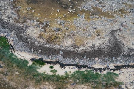 Wild sea coastline texture, from above view Reklamní fotografie