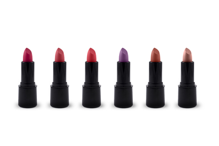 Lipsticks lineup various colors white background
