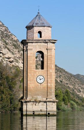 inundated: churches ruin in Reservoir Riba-roja, spain