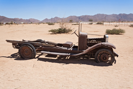 solitaire: Old rusted car in front of the gas station Solitaire, Namibia Stock Photo