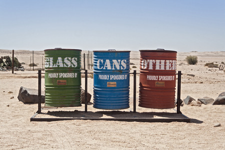 ton: separate waste collection at the edge of the road through the Welwitschia Plains, Namibia