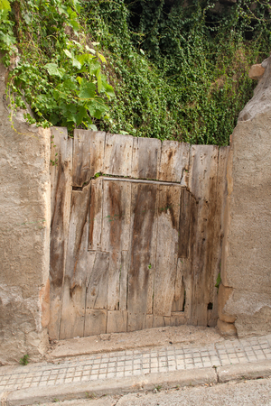 crooked: an old wooden door in Spain crooked