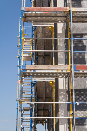 scaffolder: Scaffolding providing platforms for the ongoing work on a new house Stock Photo
