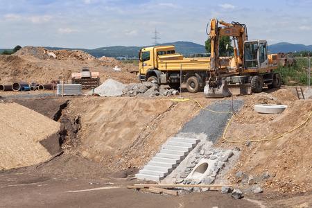 housing development: construction of a rainwater retention basin for a housing development Stock Photo