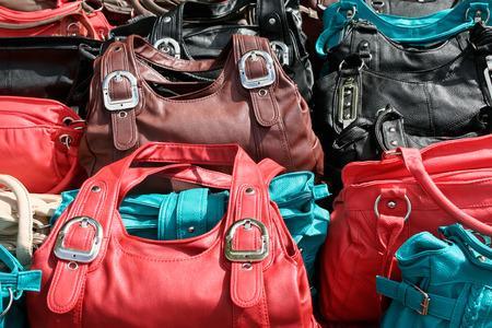 rummage: Different colored plastic handbags at a market