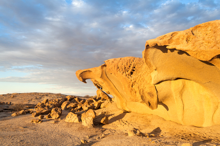 formations: massive orange granite rock formation in sunset, Namibia