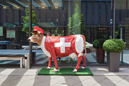 garden styles: china cow in Swiss design in front of a hotel in Frankfurt, Germany Editorial