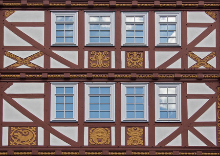 half timbered house: old half timbered house facade with ornaments in the open air museum Hessenpark, Neu Anspach, Germany