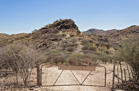 north gate: farm gate with warning sign north of Windhoek Namibia Stock Photo