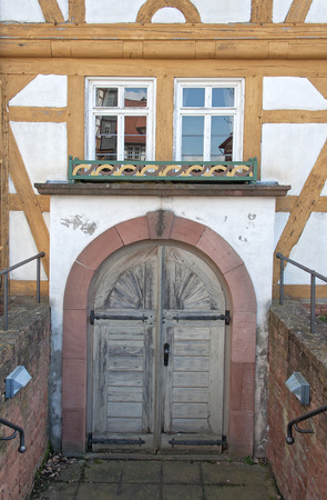 timbered: wooden door in a half timbered house Stock Photo