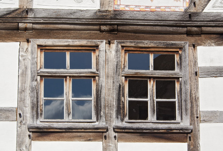 half timbered house: two windows in an old half timbered house