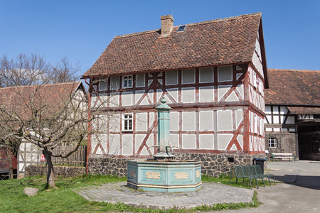 timbered: Old half timbered house with fountain at the Hessenpark Open-Air Museum Editorial
