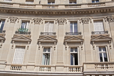 old windows: the old house with balconies and windows in Paris, France