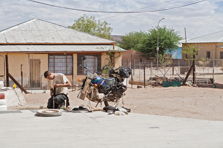 absorber: Motorcycle tire change at a petrol station in Maltahoehe, Namibia