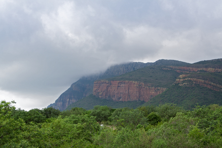 rainclouds: Rain clouds over the masif of the waterberg in South Africa Stock Photo