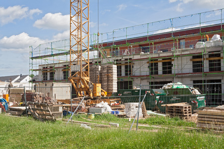 industry architecture: Building site with new houses under construction