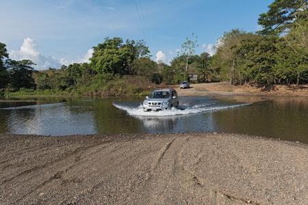 Car at a river crossing near Drake, Costa Rica Editorial